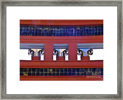 Threereflective Columns Framed Print