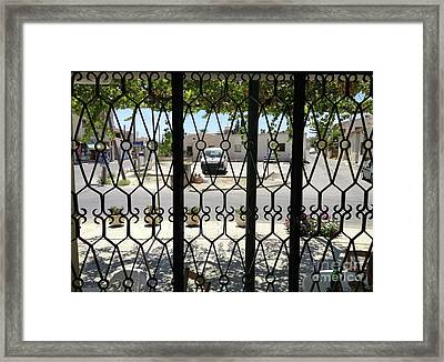 Through The Cafe Window Framed Print
