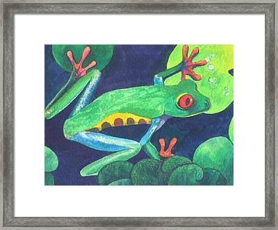 Through The Lily Pads. Framed Print