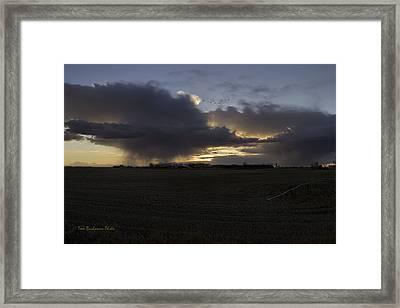 Thunder On The Prairie Framed Print by Tom Buchanan