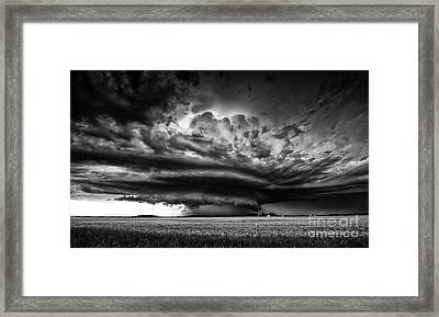 Thunder On The Prairies Framed Print by Dan Jurak