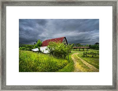Thunder Road Framed Print by Debra and Dave Vanderlaan
