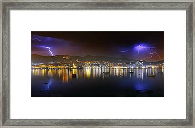 thunderstorm over Portugalete Framed Print by Mikel Martinez de Osaba