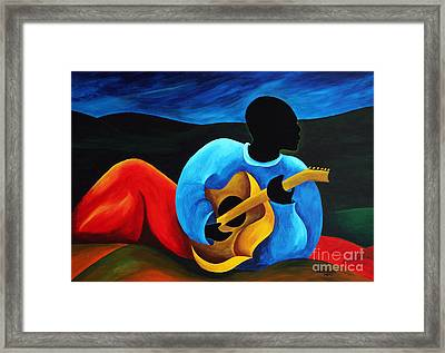 Ti Jean Le Guitariste Framed Print by Patricia Brintle