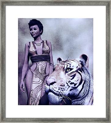 Tigress Framed Print by Maynard Ellis