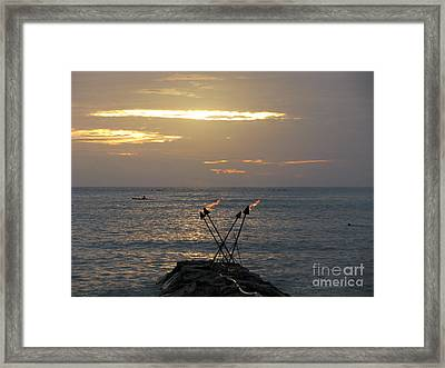 Tiki Torches In The Sunset Framed Print