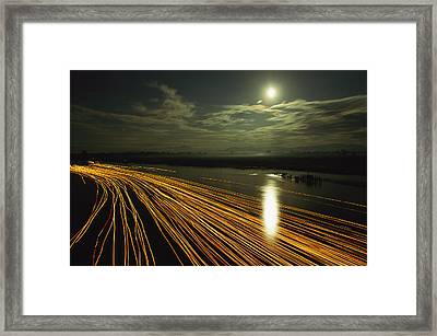 Time Lapse Of Lights From Boats Moving Framed Print