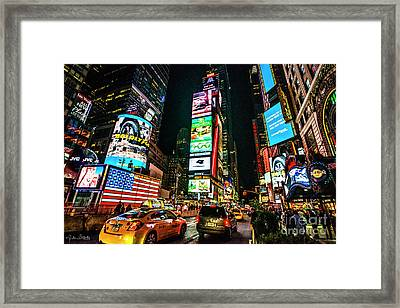 Time Square At Night Framed Print by Julian Starks