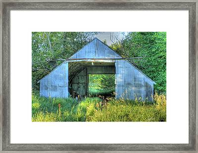 Tin Supply Framed Print