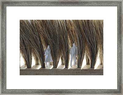 Tiny Man And Woman Hiding In A Brush Framed Print