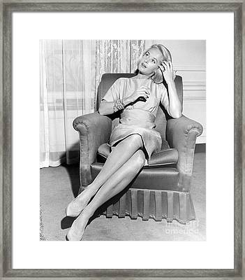 Tippi Hedren Posing In Chair During The Filming Of Alfred Hitchcock's The Birds. 1963 Framed Print by Anthony Calvacca