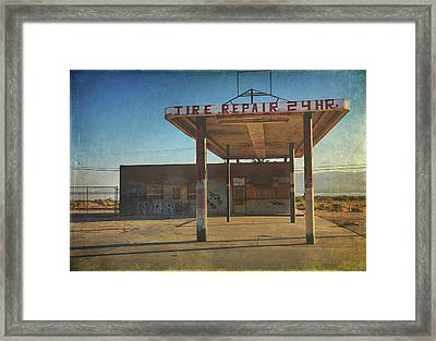 Tire Repair Framed Print