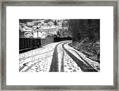 Tire Tracks In The Snow Framed Print by John Rizzuto