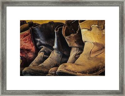 Tired Boots Framed Print