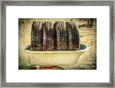 Tires In The Bathtub Framed Print