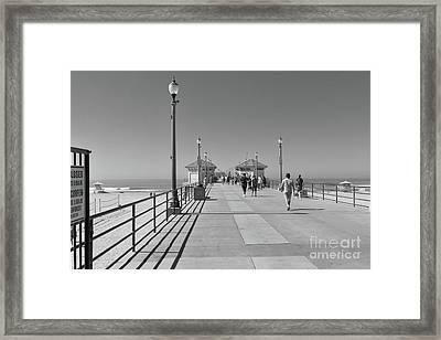 Framed Print featuring the photograph To The Sea On Huntington Beach Pier by Ana V Ramirez