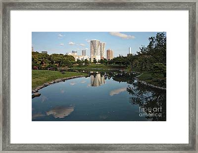 Tokyo Buildings And Garden Pond Framed Print by Carol Groenen