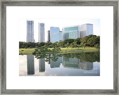 Tokyo Skyline Reflection Framed Print by Carol Groenen