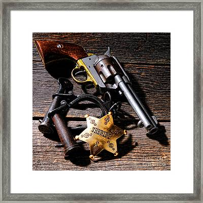 Tools Of Western Justice Framed Print by Olivier Le Queinec