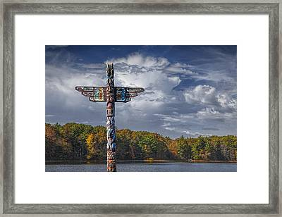Totem Pole During Autumn By A Lake Framed Print
