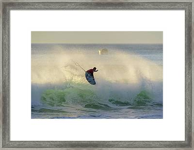 Touch The Sun Framed Print by Thierry Bouriat