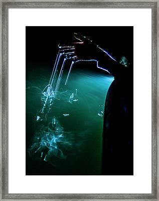 Touching Liquid Fire Framed Print by Karl Alexander