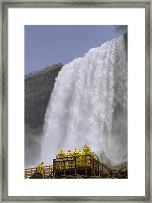 Tourists In Protective Rain Clothing Framed Print