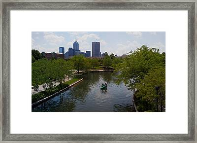 Tourists On Paddleboat In A Lake Framed Print
