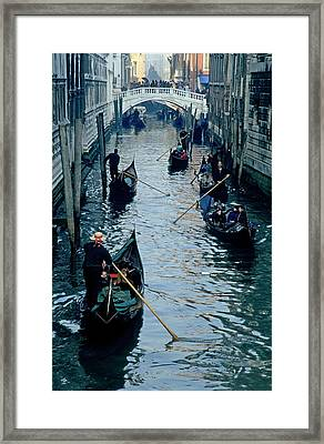 Tourists Travelling On Gondolas Through A Narrow Canal In Venice Framed Print by Sami Sarkis