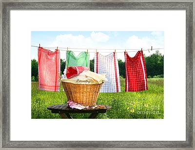 Towels Drying On The Clothesline Framed Print by Sandra Cunningham