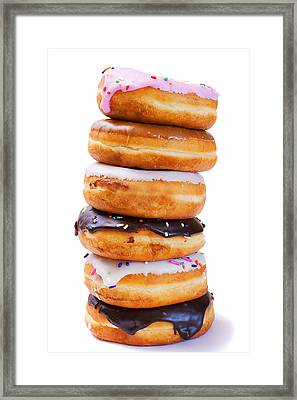 Tower Of Freshly Baked Donuts With Icing Framed Print by Donald  Erickson