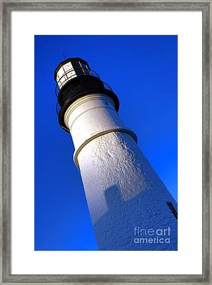 Framed Print featuring the photograph Towering Portland Head Light by Olivier Le Queinec