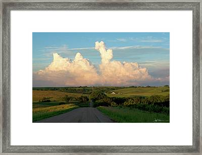 Towering Trouble Framed Print