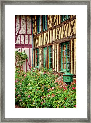 Townhouse In Normandy Framed Print by Olivier Le Queinec