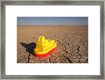 Toy Boat & Dry Lake Framed Print by GIPhotoStock