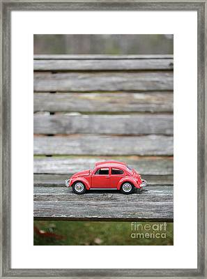 Toy Car On A Bench Framed Print by Edward Fielding