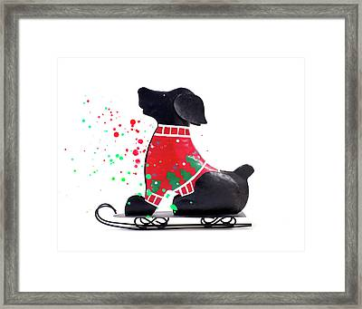 Toy Dog On Sled Christmas Framed Print by Donald Erickson