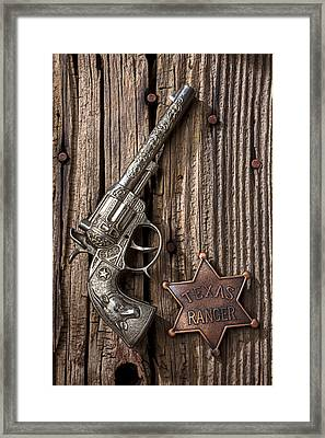 Toy Gun And Ranger Badge Framed Print by Garry Gay