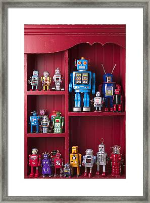 Toy Robots On Shelf  Framed Print by Garry Gay