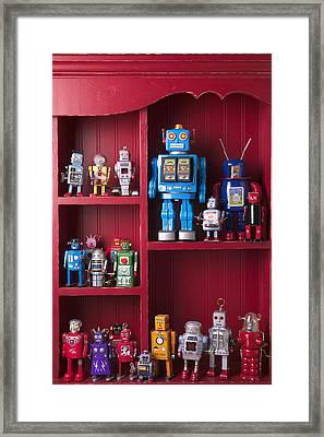 Toy Robots On Shelf  Framed Print