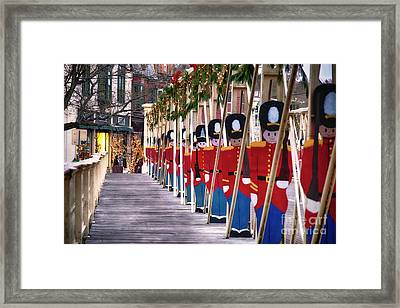 Toy Soldiers On A Bridge Framed Print by George Oze