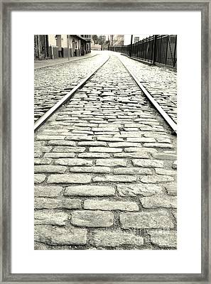Tracks In The Road Framed Print