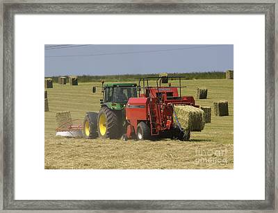Tractor Bailing Hay At Harvest Time Framed Print by Andy Smy