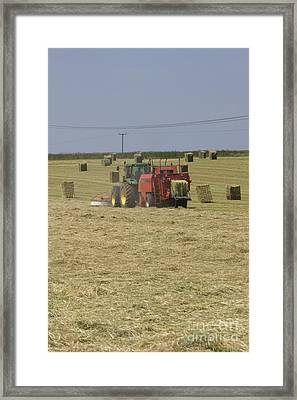 Tractor Bailing Hay In A Field At Harvest Time Pt Framed Print by Andy Smy