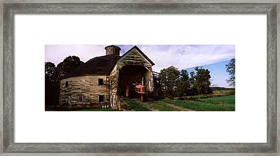 Tractor Parked Inside Of A Round Barn Framed Print by Panoramic Images