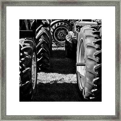 Tractor Tire Lineup Framed Print by Luke Moore