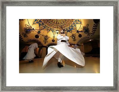 Traditional Turkish Sufi Whirling Dervish Spiritual Dance. Goreme, Cappadocia, Turkey Framed Print