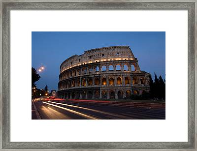 Traffic Goes By The Colosseum At Night Framed Print by Joel Sartore