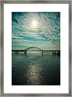 Traffic On The Bridge Framed Print by Michel Filion