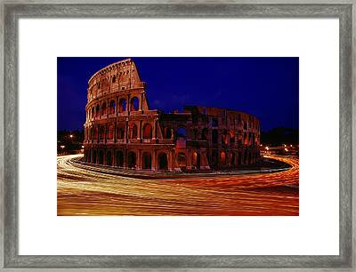 Traffic Races Around The Ruins Framed Print by Winfield Parks